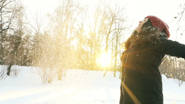 Woman throwing snow in the air. video
