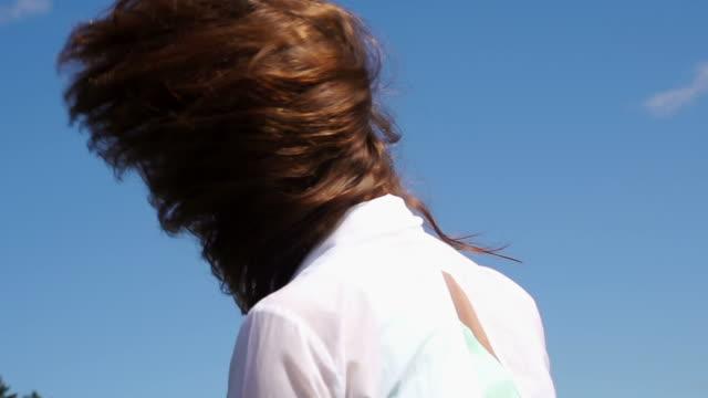 Woman throws her hair video