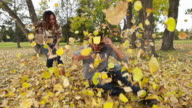 Woman throws leaves on man video