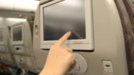 Woman touch airplane monitor video