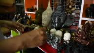 Woman tourist choosing a souvenir at souvenir shop in Thailand. video