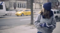 woman tourist is looking for an address with a GPS navigator on a smartphone video
