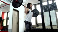 Woman training with weights video