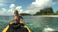 Woman traveling by boat along the coast of Indonesian Islands video