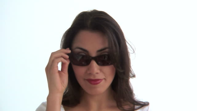 Woman tries on glasses video
