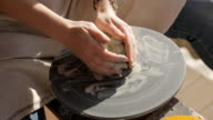 Woman tries to learn craftsmanship pottery to create clay articles video