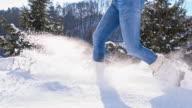 SLO MO Woman Trudging Through Snow video