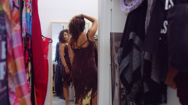 Woman Trying on Clothes in Vintage Store video