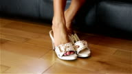 Woman Trying On White Shoes video