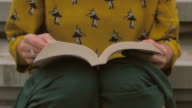 Woman turning pages of a book video
