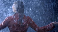 Woman Twirling In The Rain video
