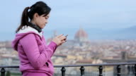 Woman types on her smartphone/ Florence, Italy video