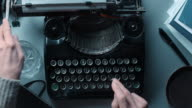 LD POV Woman typing a letter on old typewriter. video