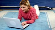 Woman typing on laptop in the her hoom. video