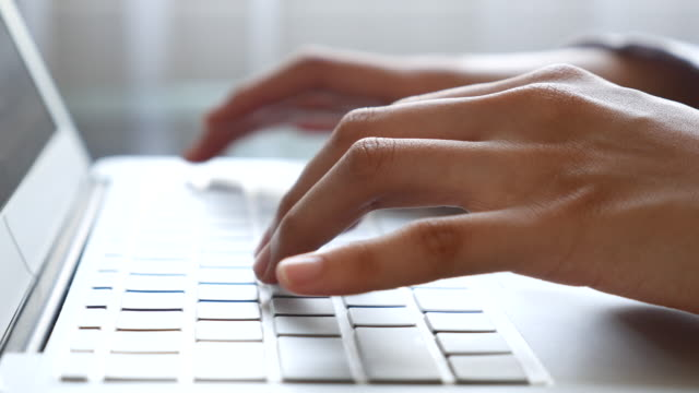 Woman Typing On Laptop Keyboard,Close-up video