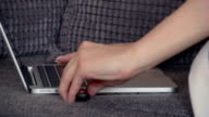 Woman typing on laptop, removing USB stick video