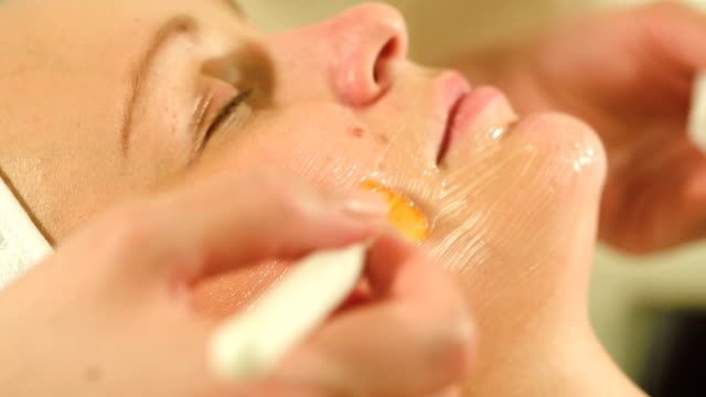 Woman under facial spa procedure video