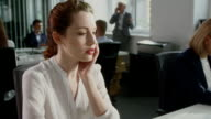 Woman under stress at work. Corporate business video