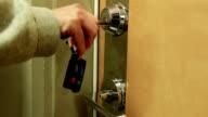 Woman unlocks a house's door video