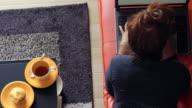 Woman use laptop on sofa video