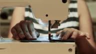 woman use sewing machine video