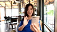 Woman use smart phone camera for online communication video