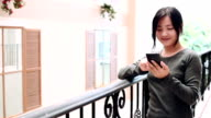 Woman use smart phone video