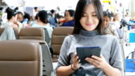 Woman use social media for communication at the airport video
