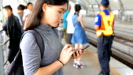 Woman use social media for communication in the sky train video
