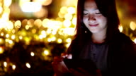 Woman use Tablet at Night and Bokeh video