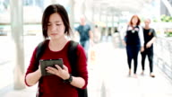 Woman use tablet to search location video