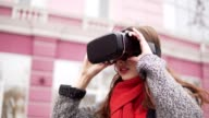 woman uses a virtual reality glasses at the street video
