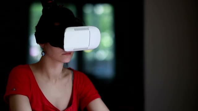 Woman using 3D Virtual Reality headset video