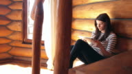 Woman using a digital tablet inside of the cabin. video