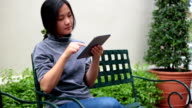 Woman using a tablet at moder park video