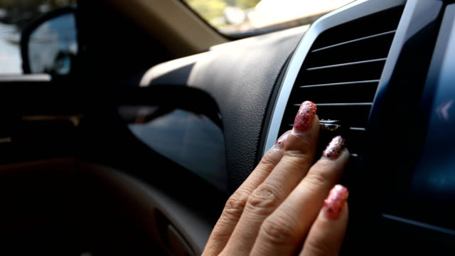 woman using air conditioner in car video