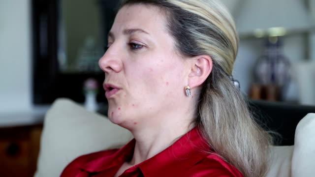 woman using asthma inhaler video