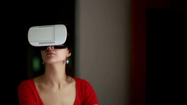 woman using augmented reality headset at home video