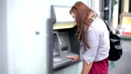 Woman using credit card at ATM video