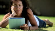 Woman using digital table in nature video