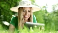 Woman using digital tablet in park II video