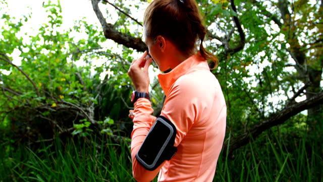 Woman using earphones video