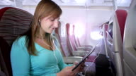 Woman using e-reader on the plane video