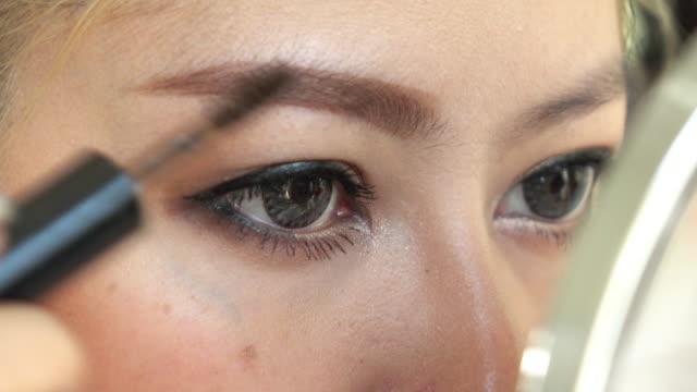 woman using eyebrow brush makeup beauty video