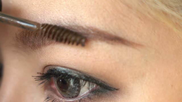 woman using eyebrow brush video