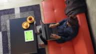 Woman using green screen Digital Tablet in living room video