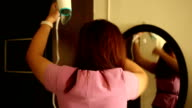 Woman Using Hairdryer in front of mirror video