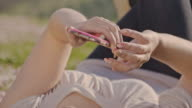 DS Woman using her smart phone in the nature video