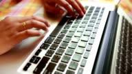 Woman using laptop computer video