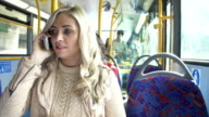 Woman Using Mobile Phone On Bus Journey video